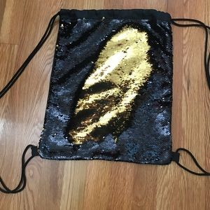 Accessories - Reversible sequin drawstring backpack. Never Used